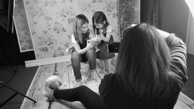 Portrait of sisters at home studio