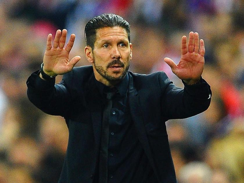 MADRID, SPAIN - APRIL 09: Diego Simeone, Coach of Club Atletico de Madrid gives instructions during the UEFA Champions League Quarter Final second leg match between Club Atletico de Madrid and FC Barcelona at Vicente Calderon Stadium on April 9, 2014 in Madrid, Spain. (Photo by Laurence Griffiths/Getty Images)