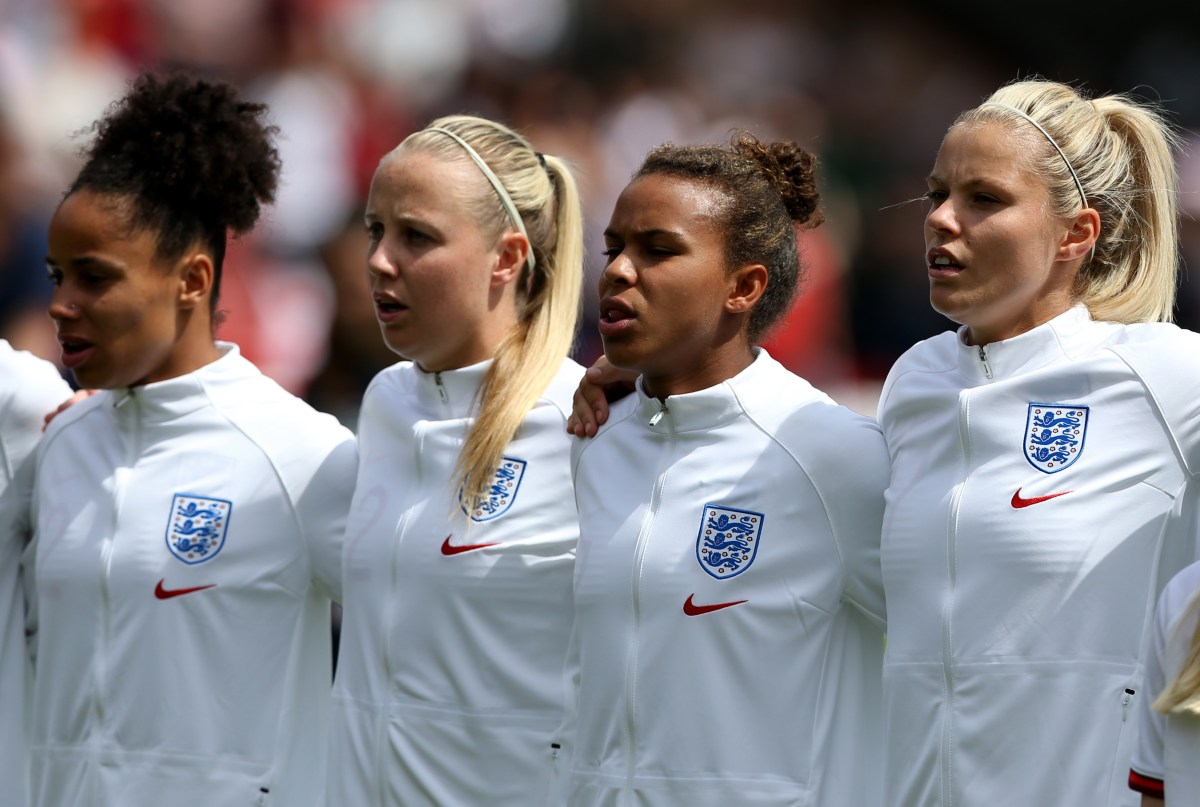England women's national team players lining up to sing the national anthem