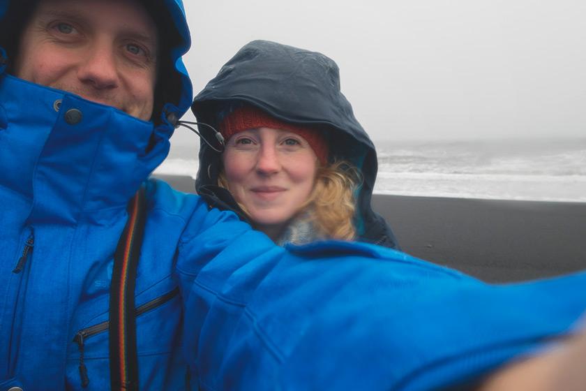 Us on on a black sand beach