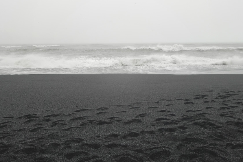 Black sand and waves