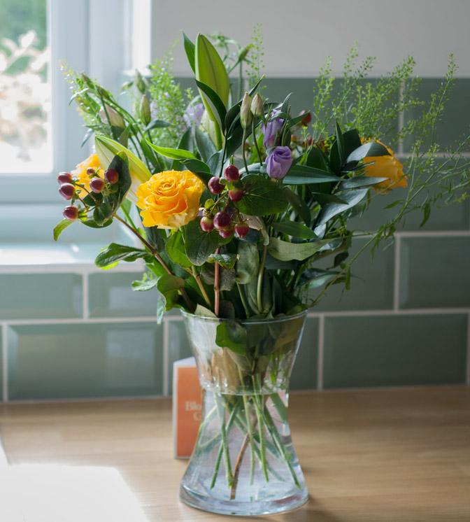 Vase of Autumn Warmth flowers