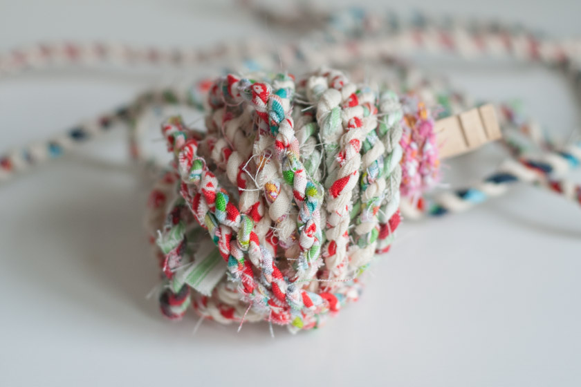 Fabric twisted into twine