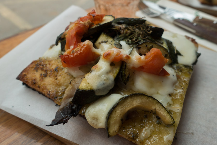 Focaccia topped with cheese and vegetables