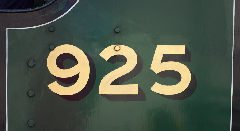 Gold letters on green train