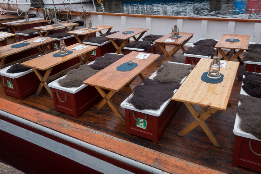 Wooden tables on boat