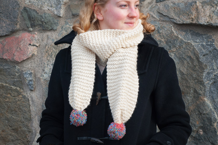 Cream scarf with coloured pompoms