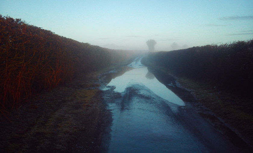 Big puddle on country road