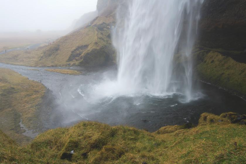 View behind waterfall