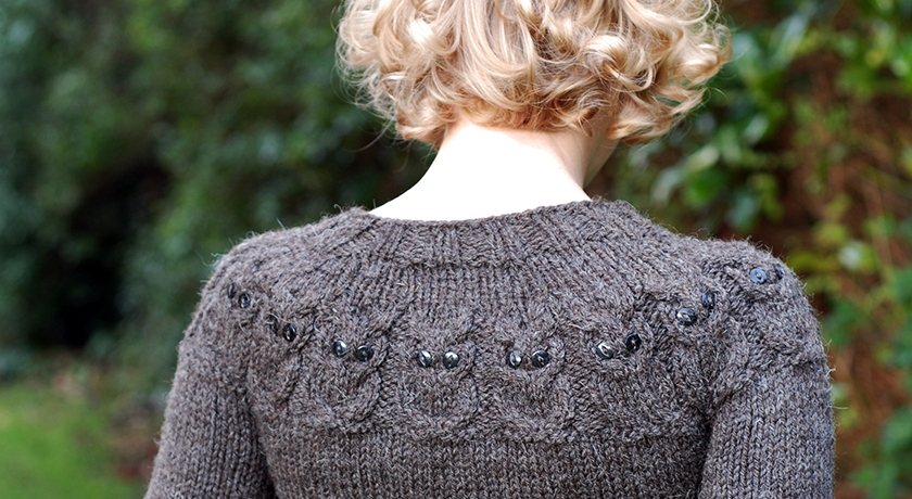 Back and neck of owl jumper