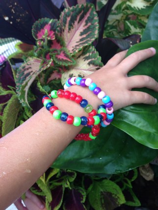 Ms 4 modelling some bracelets.