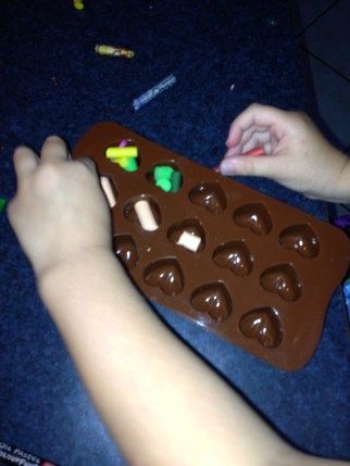 Fill the moulds with small pieces of crayon