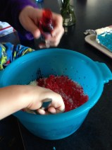 Mr 3 mixing in the food colouring.