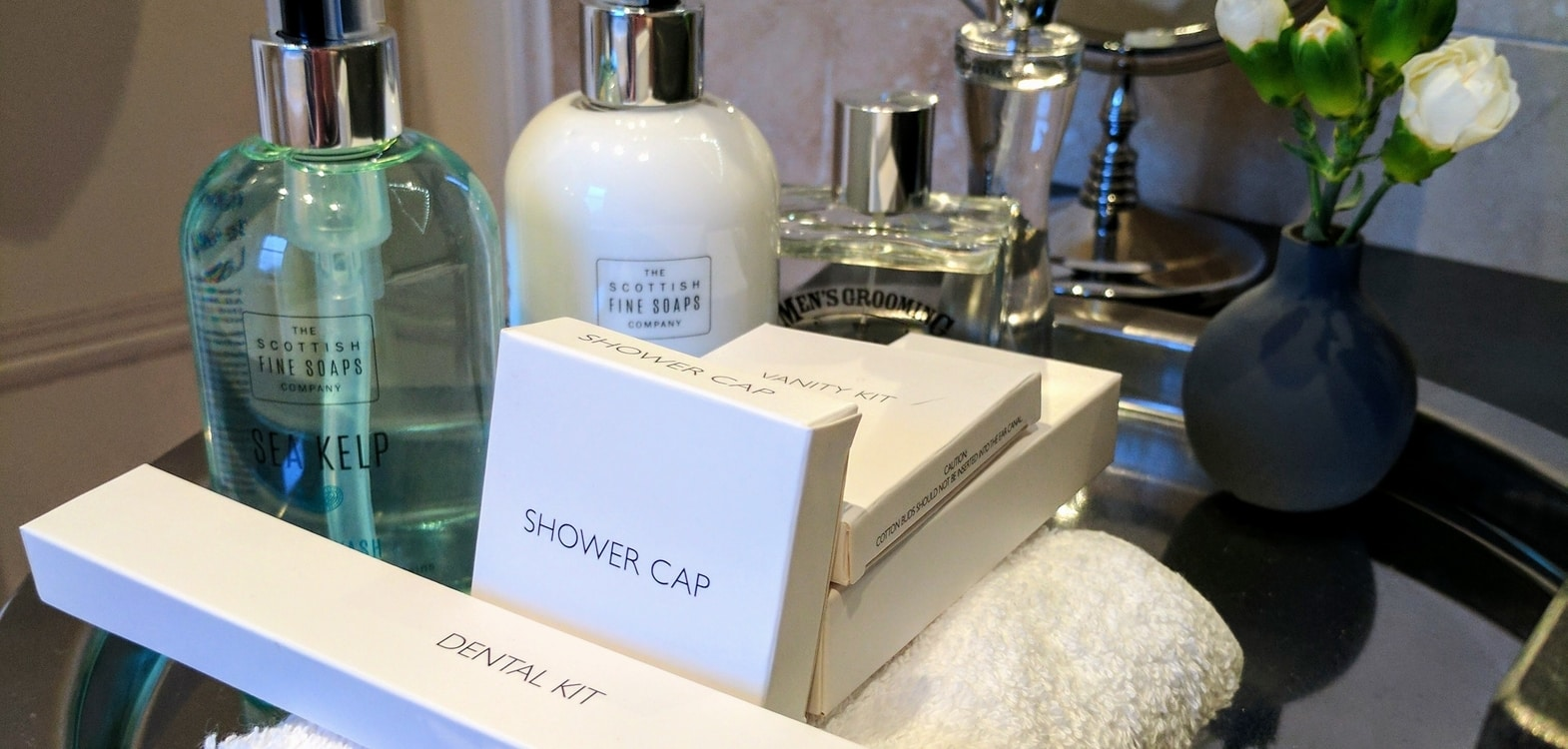 Selection of Scottish Fine Soaps items including shower gel, shower cap, dental kit