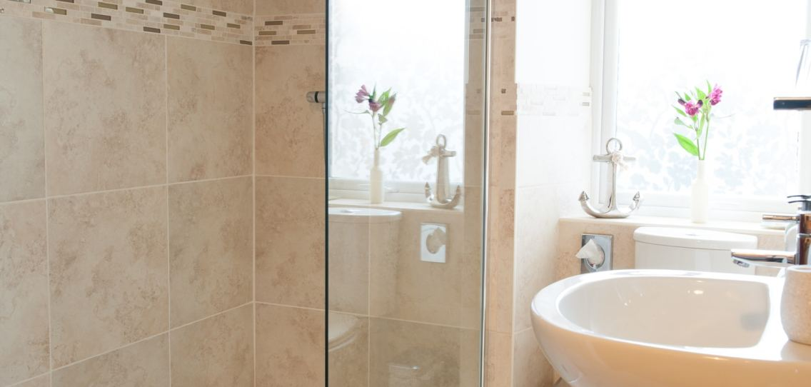 White bathroom sink and open walk in shower in the Juniper room at Strathallan Guest House