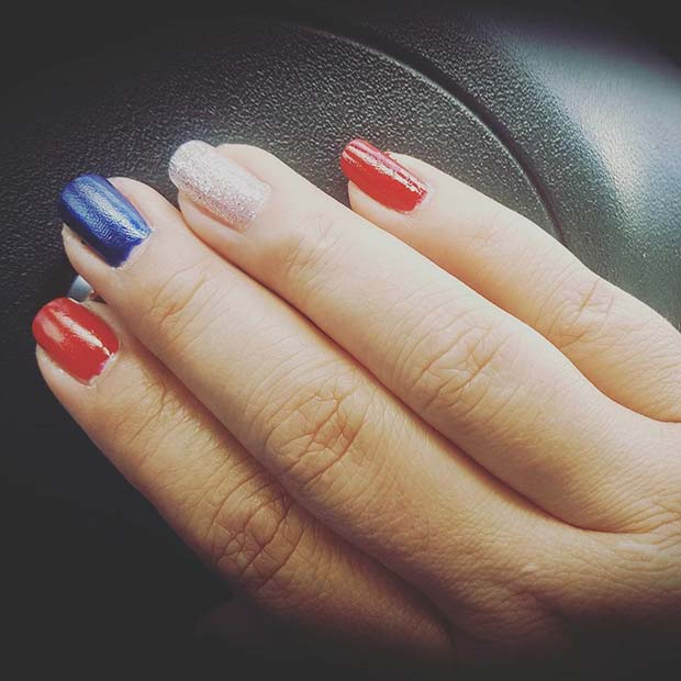 Blue and Red Nails With Silver Sparkly Accent Nail for 4th July Nail Art Design