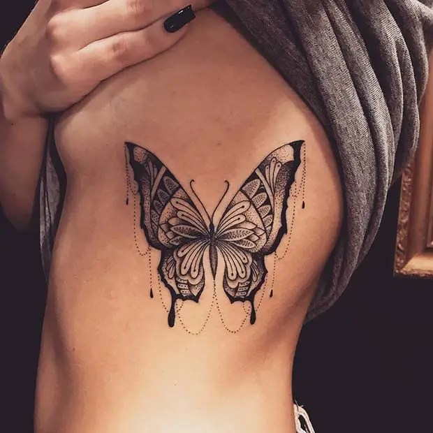 25 Bad-Ass Rib Tattoos to Inspire Your Next Ink