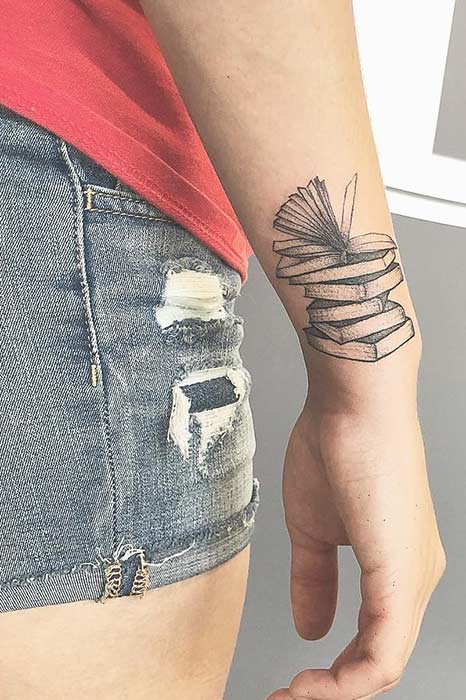 Stack of Books Arm Tattoo