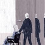 man pushing mother in wheelchair