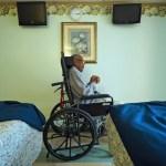 elderly man in wheelchair in nursing home