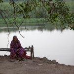 An elderly woman along the Yamuna River near New Delhi