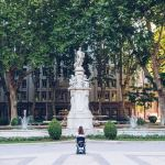 woman in motorized wheelchair in front of large fountains