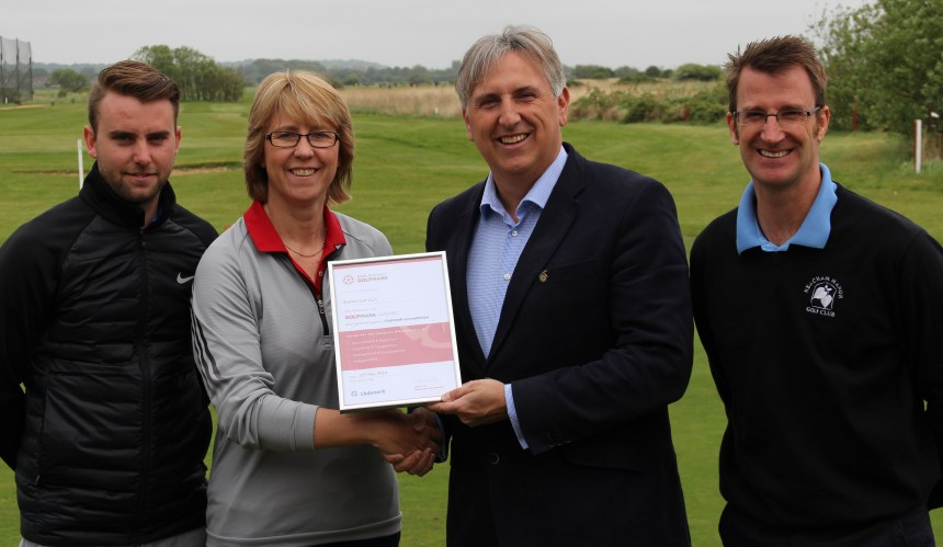 Mark of success: celebrating the award are, from left, Luke Harris, Searles Golf assistant manager; Karen Woodrow, England Golf county development officer for Norfolk; Paul Searle, managing director, and Edd Howes, golf manager at Searles Leisure Resort