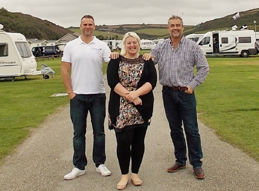 Holiday smiles: Porth Beach Holiday Park managers Chris and Katy Case (left) with the business's Dennis May