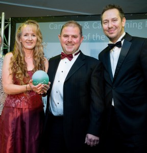 Winning smiles: Lynette and Jamie Cook are presented with their award by (right) Mark Warnes, property and portfolio director of sponsors Hoseasons