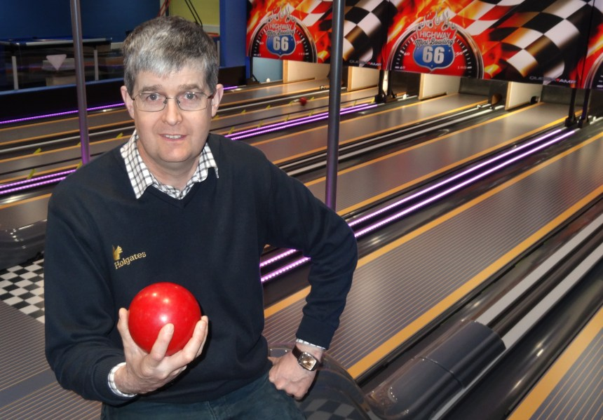 Having a ball: Michael Holgate at the park's US-style bowling alley, one of the attractions for New Year guests