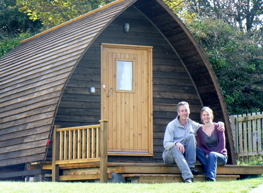 Richard and Julia Barnes relax outside one of their park's popular wigwams, complete with all home comforts
