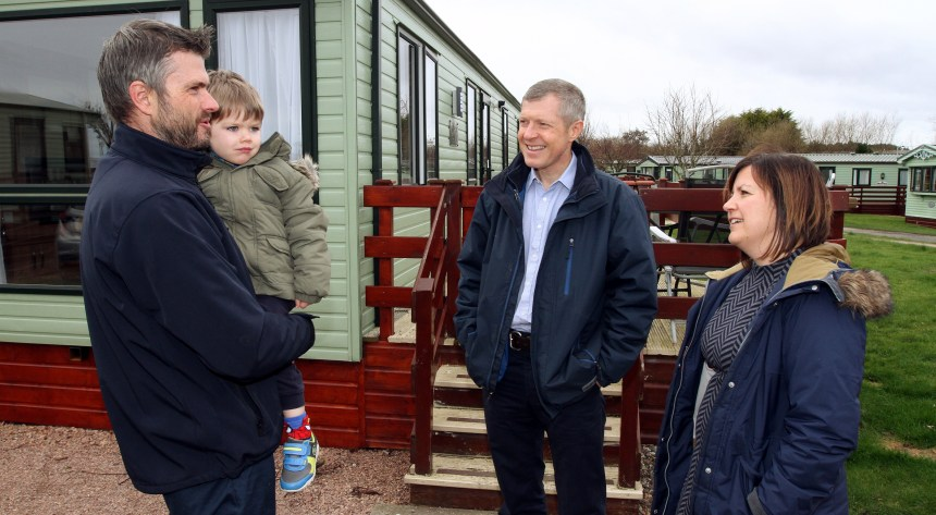 MSP Willie Rennie (centre) joins Douglas Baillie and his wife Sonia, with their son Angus (3), on a park tour