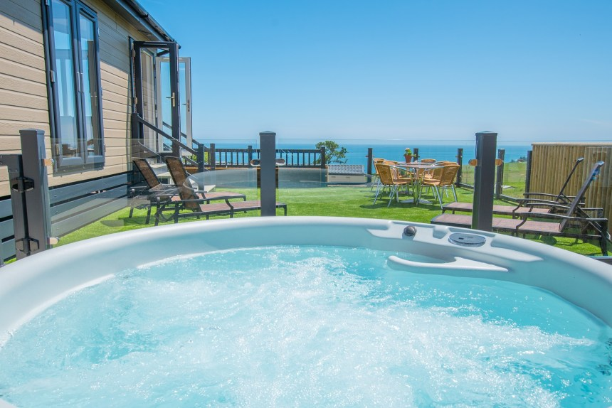 From their own private hot-tub, guests can enjoy delightful views of the Jurassic Coast and the sparkling sea