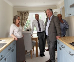 Mr Davies steps inside one of the park's modern, light and spacious park homes