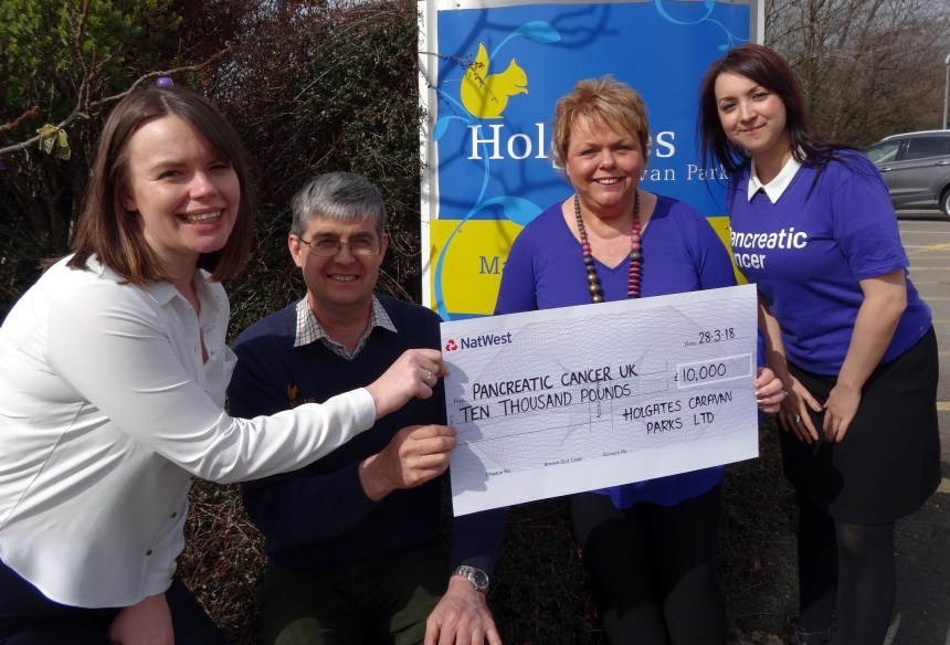 Silverdale park's Jessica Douglas (left) and Michael Holgate present the cheque to charity chiefs Lynn and Amy