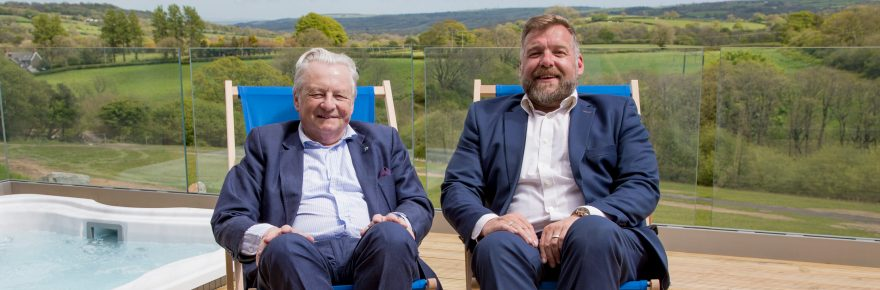 Peerless views: Lord Dafydd Elis-Thomas (left) joins Huw Pendleton outside one of the park's hot-tub lodges