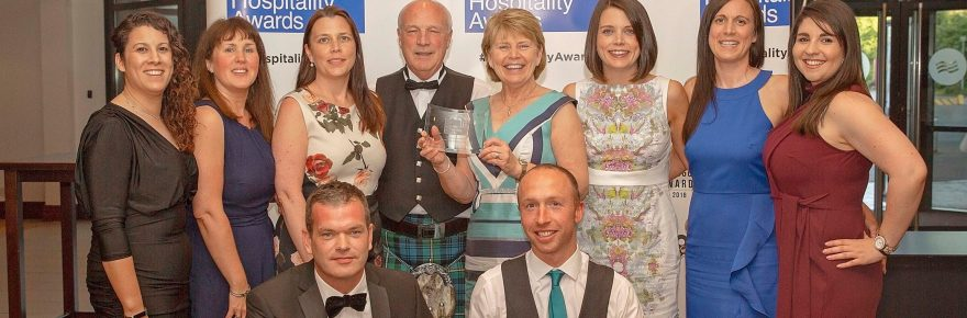 Colin and Margaret Wood (rear, centre) with other family members and senior staff at the awards ceremony