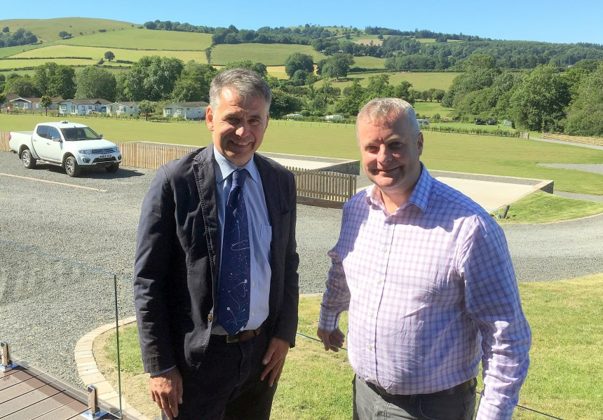 Chris Davies MP (right) explores the scenic grounds of Rockbridge park in Powys with business co-owner Glenn Jones