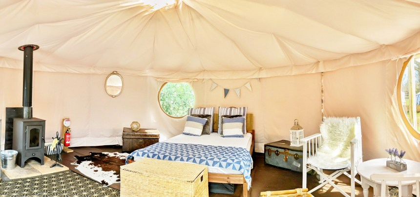 The park's glamping tents (above) are perfect just for two… as long as both guests are old enough to vote
