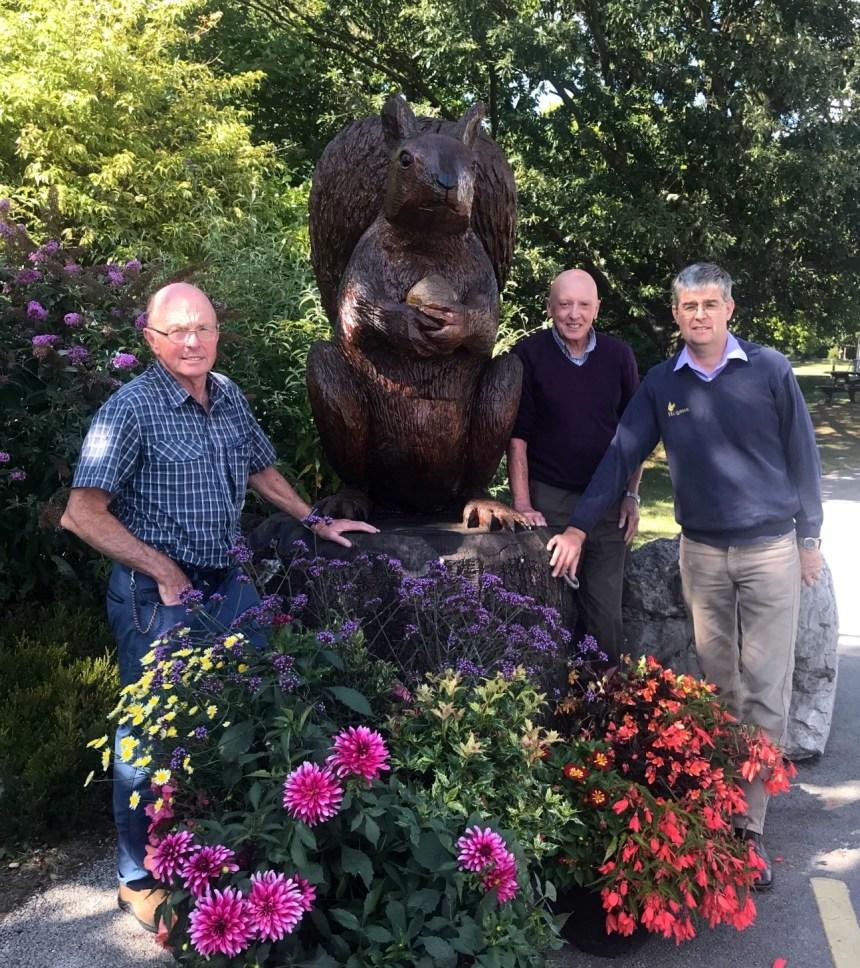 Mawson is settled into his new home at the entrance to Silverdale Holiday Park by business owner Michael Holgate (right) and, from the Westmorland Red Squirrels charity, organisers Bob Cartwright and Bob Hamnett