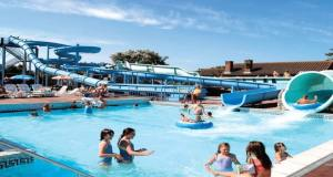 Multiple attractions at the park include a pool with fun features