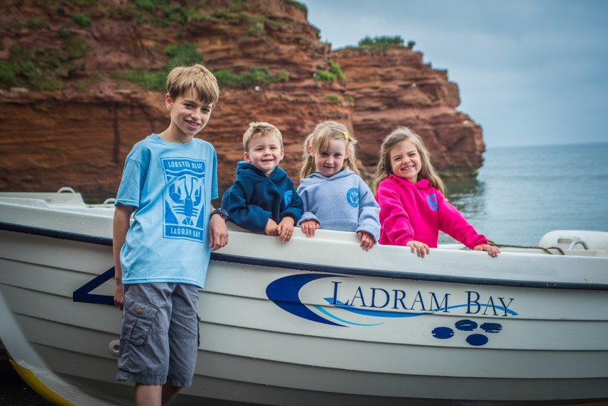 They're tops! On Ladram Bay's private beach, young fans model Ladram Bay's new Lobster Blue clothing range