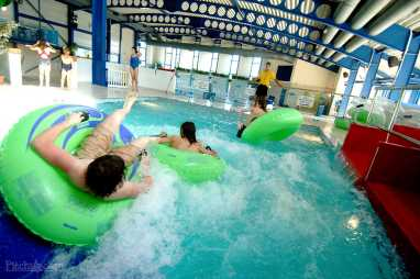 Park facilities include a large pool with flumes and other fun features