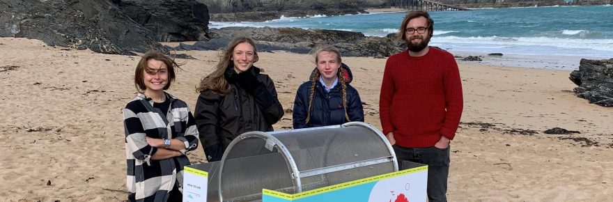Ready to roll: the new trommel on the park's beach with (from left) Hope Buck from makers Nurdle, Anna Wilsher who heads Mother Ivey's beach cleaning team, artist Veronika Niewiadomska, and Josh Beech from Nurdle