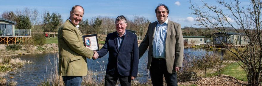 Kevin Hollinrake MP congratulates long-serving park manager Trevor Jones and business owner Mark Goodson