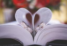 Wedding rings on a bible in church