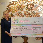 A woman receives a large cheque