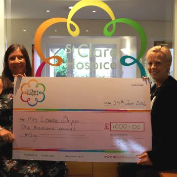 Laura Shipp receives a giant cheque