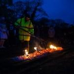 Man raking hot coals