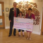 Christopher Barrett, Dunmow Rotary President, and his daughter Sonia, presenting a cheque for £3,000 to St Clare